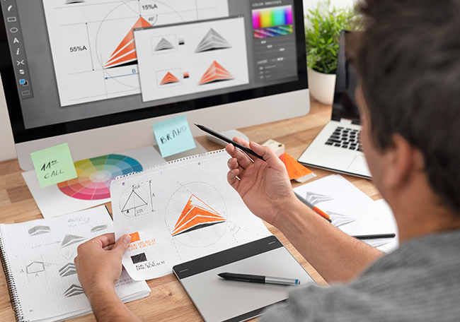graphic designer working on brand identity and logo design